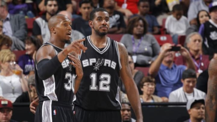 SACRAMENTO, CA – OCTOBER 8: David West #30 and LaMarcus Aldridge #12 of the San Antonio Spurs look on against the Sacramento Kings during a preseason game on October 8, 2015 at Sleep Train Arena in Sacramento, California. NOTE TO USER: User expressly acknowledges and agrees that, by downloading and or using this photograph, User is consenting to the terms and conditions of the Getty Images Agreement. Mandatory Copyright Notice: Copyright 2015 NBAE (Photo by Rocky Widner/NBAE via Getty Images)