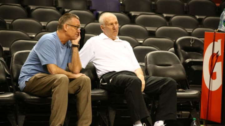 SAN ANTONIO, TX JUNE 04: General Manager, R.C.Buford and head coach Gregg Popovich of the San Antonio Spurs talk during practice as part of the 2014 NBA Finals on June 04, 2014 at AT&T Center in San Antonio, Texas. NOTE TO USER: User expressly acknowledges and agrees that, by downloading and or using this photograph, User is consenting to the terms and conditions of the Getty Images License Agreement. Mandatory Copyright Notice: Copyright 2014 NBAE (Photo by Nathaniel S. Butler/NBAE via Getty Images)