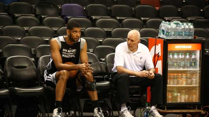 SAN ANTONIO, TX JUNE 04: Tim Duncan #21 and head coach Gregg Popovich of the San Antonio Spurs talk during practice as part of the 2014 NBA Finals (Photo by Nathaniel S. Butler/NBAE via Getty Images)
