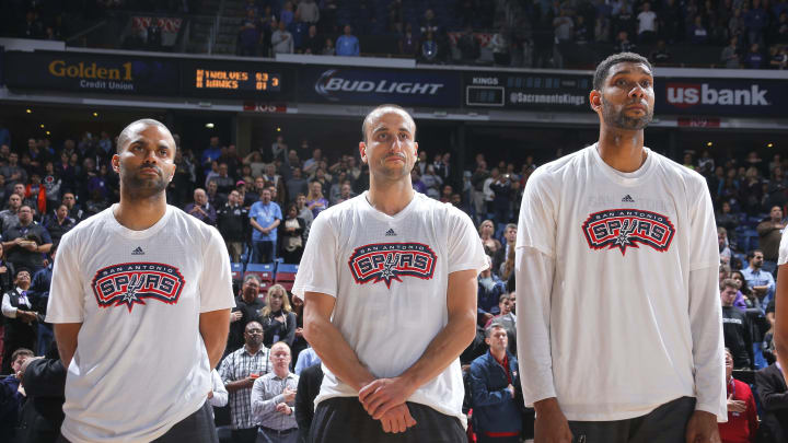 SACRAMENTO, CA – NOVEMBER 9: Tony Parker #9, Manu Ginobili #20 and Tim Duncan #21 of the San Antonio Spurs line up for the national anthem (Photo by Rocky Widner/NBAE via Getty Images)