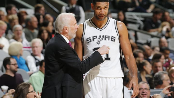 SAN ANTONIO, TX - DECEMBER 2: Head coach Gregg Popovich of the San Antonio Spurs and Tim Duncan #21 of the San Antonio Spurs talk during the game against the Milwaukee Bucks on December 2, 2015 at the AT&T Center in San Antonio, Texas. NOTE TO USER: User expressly acknowledges and agrees that, by downloading and or using this photograph, user is consenting to the terms and conditions of the Getty Images License Agreement. Mandatory Copyright Notice: Copyright 2015 NBAE (Photos by Chris Covatta/NBAE via Getty Images)