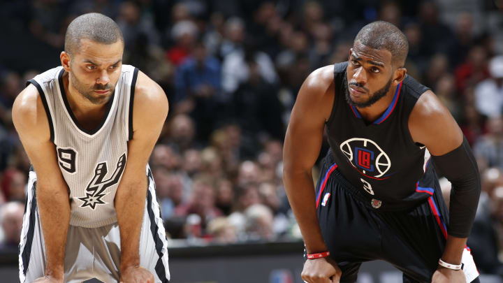 SAN ANTONIO, TX – DECEMBER 18: Tony Parker #9 of the San Antonio Spurs and Chris Paul #3 of the Los Angeles Clippers are seen during a game (Photos by Chris Covatta/NBAE via Getty Images)