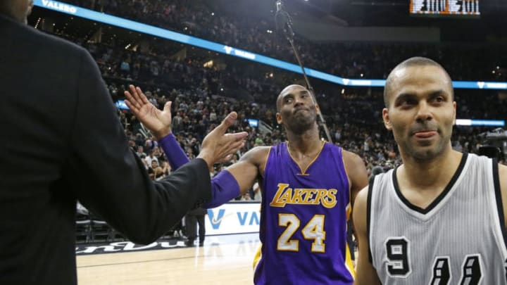 SAN ANTONIO,TX - FEBRUARY 6: Kobe Bryant #24 of the Los Angeles Lakers says his goodbye to Tim Duncan #21 of the San Antonio Spurs at the end of the game at AT&T Center on February 6, 2016 in San Antonio, Texas. Tony Parker #9 of the San Antonio Spurs is to the right of the frame. NOTE TO USER: User expressly acknowledges and agrees that , by downloading and or using this photograph, User is consenting to the terms and conditions of the Getty Images License Agreement. (Photo by Ronald Cortes/Getty Images)