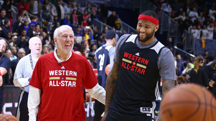 TORONTO, CANADA – FEBRUARY 13: Gregg Popovich of the San Antonio Spurs coaches DeMarcus Cousins #15 of the Sacramento Kings during the NBA All-Star Practice in 2016 (Photo by Nathaniel S. Butler/NBAE via Getty Images)