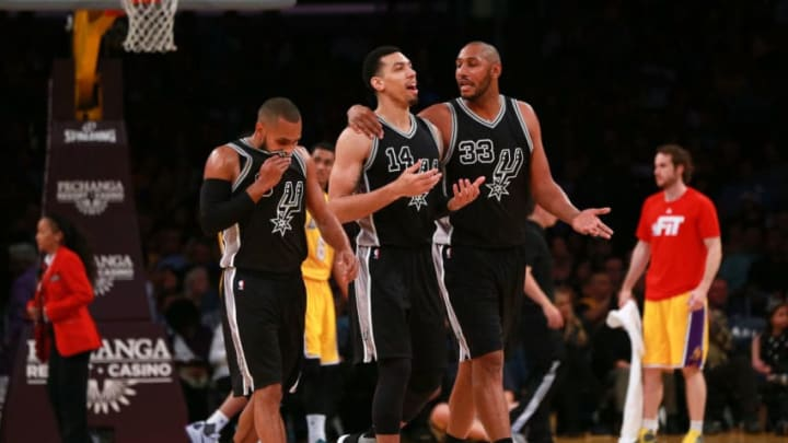 LOS ANGELES, CA - JANUARY 22: Patty Mills #8, Danny Green #14 and Boris Diaw #33 of the San Antonio Spurs walk back to the bench after a timeout during the NBA game between the San Antonio Spurs and the Los Angeles Lakers at Staples Center on January 22, 2016 in Los Angeles, California. The Spurs defeated the Lakers 108 - 95. NOTE TO USER: User expressly acknowledges and agrees that, by downloading and or using this photograph, User is consenting to the terms and conditions of the Getty Images License Agreement. (Photo by Victor Decolongon/Getty Images)