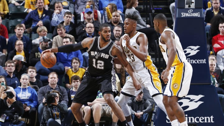 INDIANAPOLIS, IN – MARCH 7: LaMarcus Aldridge #12 of the San Antonio Spurs posts up against Myles Turner #33 of the Indiana Pacers in the first half of the game at Bankers Life Fieldhouse on March 7, 2016 in Indianapolis, Indiana. (Photo by Joe Robbins/Getty Images)