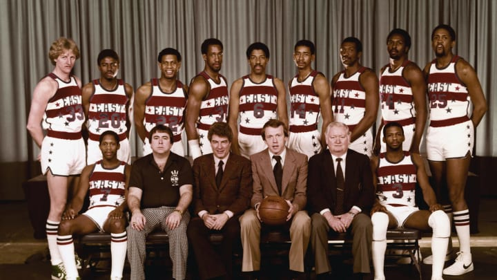 LANDOVER,MD – FEBRUARY 4: The Eastern Conference All-Stars pose for a team photo, front row (L to R): Nate Archibald, Trainer John Lally, Assistant Coach Chuck Daly, Head Coach Billy Cunningham, Assistant Coach Jack McMahon, Eddie Johnson. Back Row: Larry Bird, Micheal Ray Richardson, John Drew, Dan Roundfield, Julius Erving, George Gervin, Elvin Hayes, Moses Malone & Bill Cartwright, prior to the 1980 NBA All-Star game at the Capital Centre on February 4, 1980 in Landover, Maryland. (Photo by NBAE/NBAE via Getty Images)