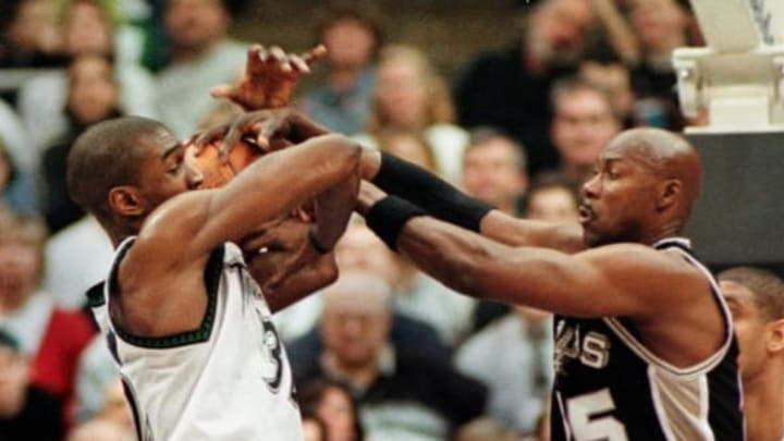 MINNEAPOLIS, UNITED STATES: San Antonio Spurs' Jerome Kersey slaps down an attempted shot by Minnesota Timberwolves' Joe Smith in the 2nd quarter of the game. The Timberwolves won 91-88 at the Target Center, 04 January, 2000, in Minneapolis, Minnesota. AFPPHOTO CRAIG LASSIG (Photo credit should read CRAIG LASSIG/AFP/Getty Images)