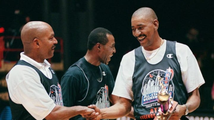 NEW YORK, UNITED STATES: Former NBA star George Gervin (R) receives congratulations from Randy Smith (L) and Jo Jo White (C) after winning the AT&T Legends Shootout 06 February in New York. Gervin defeated White in the competition that is part of the NBA All-Star weekend, preceeding the All-Star game 08 February. AFP PHOTO Stan HONDA (Photo credit should read STAN HONDA/AFP via Getty Images)