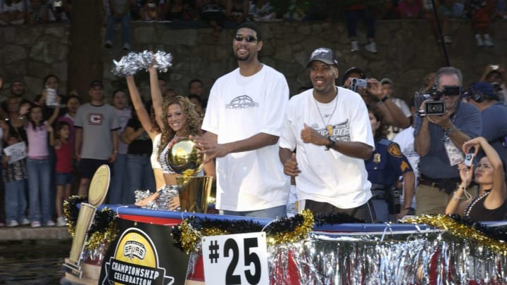 SAN ANTONIO – JUNE 25: San Antonio Spurs players Tim Duncan and Bruce Bowen celebrate with over 300,000 San Antonians that crowded the River Walk in celebration of the Spurs third NBA Championship in seven years at San Antonio River Walk on June 25, 2005 in San Antonio, Texas. (Photo by D. Clarke Evans/NBAE via Getty Images)
