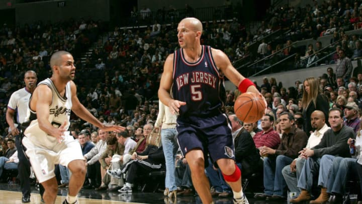 SAN ANTONIO - JANUARY 10: Jason Kidd #5 of the New Jersey Nets looks to drive against Tony Parker #9 of the San Antonio Spurs on January 10, 2006 at the SBC Center in San Antonio, Texas. NOTE TO USER: User expressly acknowledges and agrees that, by downloading and or using this photograph, User is consenting to the terms and conditions of the Getty Images License Agreement. Mandatory Copyright Notice: Copyright 2006 NBAE (Photo by Chris Birck/NBAE via Getty Images)