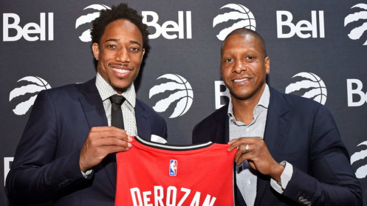 TORONTO, CANADA - JULY 14: DeMar DeRozan #10 and Masai Ujiri of the Toronto Raptors pose for a photo during a press conference after announcing his new deal on July 14, 2016 at the Real Sports Bar & Grill in Toronto, Ontario, Canada. NOTE TO USER: User expressly acknowledges and agrees that, by downloading and or using this Photograph, user is consenting to the terms and conditions of the Getty Images License Agreement. Mandatory Copyright Notice: Copyright 2016 NBAE (Photo by Ron Turenne/NBAE via Getty Images)