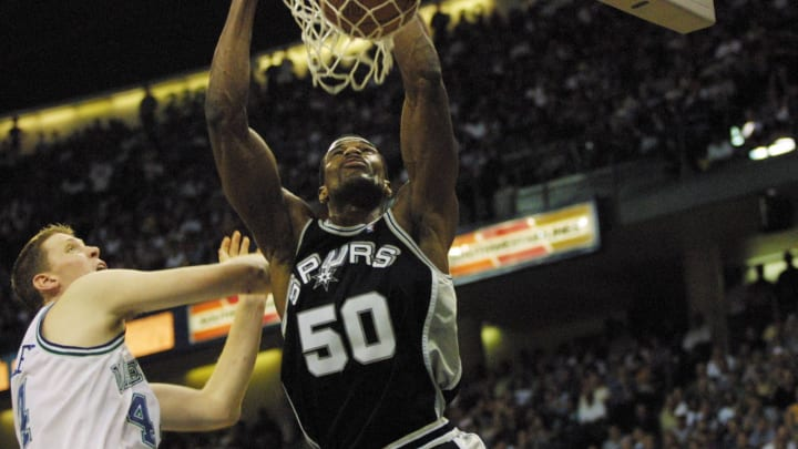 9 May 2001: David Robinson #50 of the San Antonio Spurs slam-dunks against the Dallas Mavericks in game three of round two of the NBA playoffs at Reunion Arena in Dallas, Texas. The Spurs won 104-90. DIGITAL IMAGE. Mandatory Credit: Tom Hauck/Allsport
