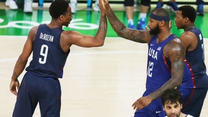 RIO DE JANEIRO, BRAZIL - AUGUST 21: Demar DeRozan #9 of United States and Demarcus Cousins #12 of United States react during the Men's Gold medal game on Day 16 of the Rio 2016 Olympic Games at Carioca Arena 1 on August 21, 2016 in Rio de Janeiro, Brazil. (Photo by Christian Petersen/Getty Images)