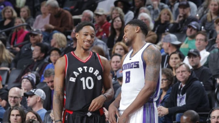 SACRAMENTO, CA - NOVEMBER 20: DeMar DeRozan #10 of the Toronto Raptors and Rudy Gay #8 of the Sacramento Kings talk during the game on November 20, 2016 at Golden 1 Center in Sacramento, California. NOTE TO USER: User expressly acknowledges and agrees that, by downloading and or using this photograph, User is consenting to the terms and conditions of the Getty Images Agreement. Mandatory Copyright Notice: Copyright 2016 NBAE (Photo by Rocky Widner/NBAE via Getty Images)