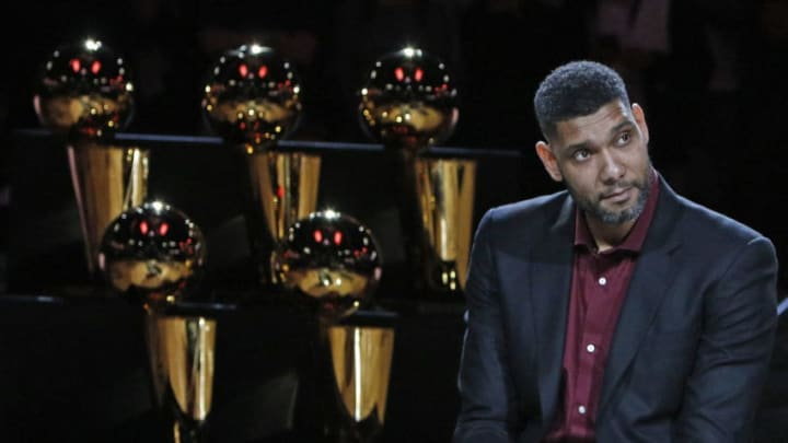 SAN ANTONIO,TX - DECEMBER 18: Former San Antonio Spurs stars Tim Duncan listens to the speeches during the ceremony honoring and retiring of Tim Duncan number after the game against the New Orleans Pelicans at AT