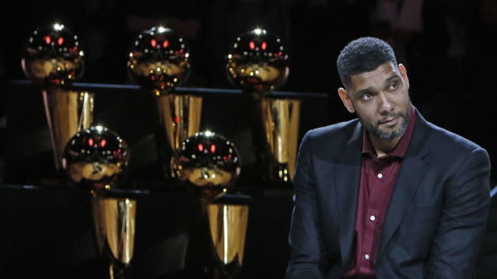 SAN ANTONIO,TX – DECEMBER 18: Former San Antonio Spurs stars Tim Duncan listens to the speeches during the ceremony honoring and retiring of Tim Duncan number after the game against the New Orleans Pelicans at AT