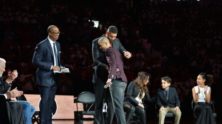 SAN ANTONIO, TX - DECEMBER 18: Tony Parker #9 of the San Antonio Spurs hugs NBA Legend Tim Duncan at his jersey retirement ceremony on December 18, 2016 at the AT&T Center in San Antonio, Texas. NOTE TO USER: User expressly acknowledges and agrees that, by downloading and or using this photograph, user is consenting to the terms and conditions of the Getty Images License Agreement. Mandatory Copyright Notice: Copyright 2016 NBAE (Photos by Mark Sobhani/NBAE via Getty Images)