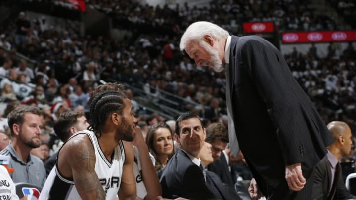 SAN ANTONIO, TX - DECEMEBR 18: Gregg Popovich of the San Antonio Spurs talks with Kawhi Leonard #2 during the game against the New Orleans Pelicans on December 18, 2016 at the AT&T Center in San Antonio, Texas. NOTE TO USER: User expressly acknowledges and agrees that, by downloading and or using this photograph, user is consenting to the terms and conditions of the Getty Images License Agreement. Mandatory Copyright Notice: Copyright 2016 NBAE (Photos by Chris Covatta/NBAE via Getty Images)