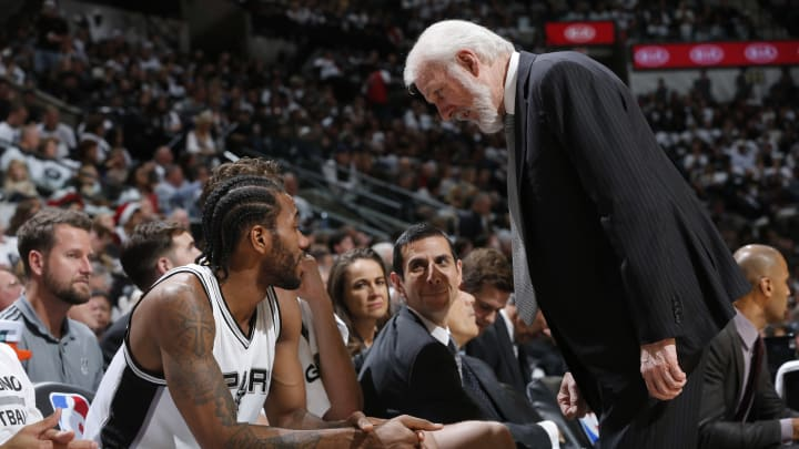 SAN ANTONIO, TX – DECEMEBR 18: Gregg Popovich of the San Antonio Spurs talks with Kawhi Leonard #2 during the game against the New Orleans Pelicans on December 18, 2016 at the AT&T Center in San Antonio, Texas. NOTE TO USER: User expressly acknowledges and agrees that, by downloading and or using this photograph, user is consenting to the terms and conditions of the Getty Images License Agreement. Mandatory Copyright Notice: Copyright 2016 NBAE (Photos by Chris Covatta/NBAE via Getty Images)
