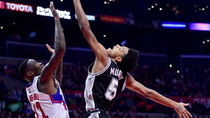 LOS ANGELES, CA – DECEMBER 22: Dejounte Murray #5 of the San Antonio Spurs gets fouled by Jamal Crawford #11 of the LA Clippers during a 106-101 Clipper win at Staples Center in 2016. (Photo by Harry How/Getty Images)
