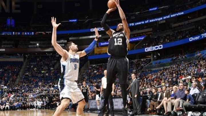 ORLANDO, FL - FEBRUARY 15: LaMarcus Aldridge #12 of the San Antonio Spurs shoots the ball against Nikola Vucevic #9 of the Orlando Magic (Photo by Fernando Medina/NBAE via Getty Images)