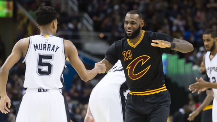 CLEVELAND, OH - JANUARY 21: Dejounte Murray #5 of the San Antonio Spurs greets LeBron James #23 of the Cleveland Cavaliers during the first half at Quicken Loans Arena on January 21, 2017 in Cleveland, Ohio. NOTE TO USER: User expressly acknowledges and agrees that, by downloading and/or using this photograph, user is consenting to the terms and conditions of the Getty Images License Agreement. Mandatory copyright notice. (Photo by Jason Miller/Getty Images)