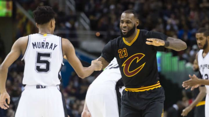 CLEVELAND, OH – JANUARY 21: Dejounte Murray #5 of the San Antonio Spurs greets LeBron James #23 of the Cleveland Cavaliers during the first half at Quicken Loans Arena on January 21, 2017 in Cleveland, Ohio. NOTE TO USER: User expressly acknowledges and agrees that, by downloading and/or using this photograph, user is consenting to the terms and conditions of the Getty Images License Agreement. Mandatory copyright notice. (Photo by Jason Miller/Getty Images)