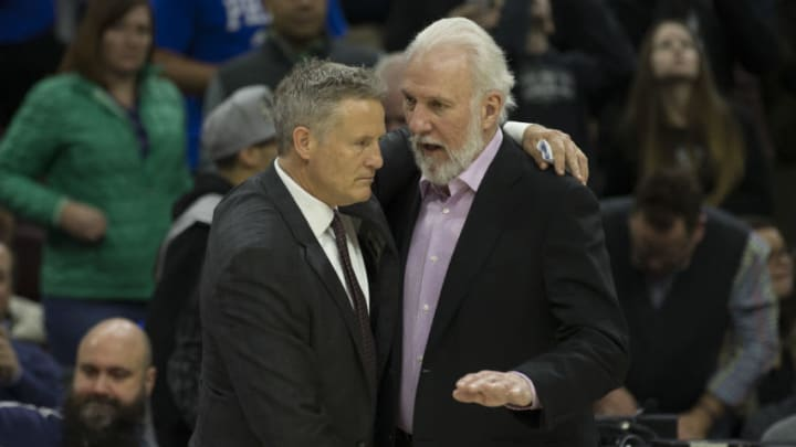 PHILADELPHIA, PA - FEBRUARY 8: Head coach Brett Brown of the Philadelphia 76ers shakes hands with head coach Gregg Popovich of the San Antonio Spurs after a game (Photo by Mitchell Leff/Getty Images)