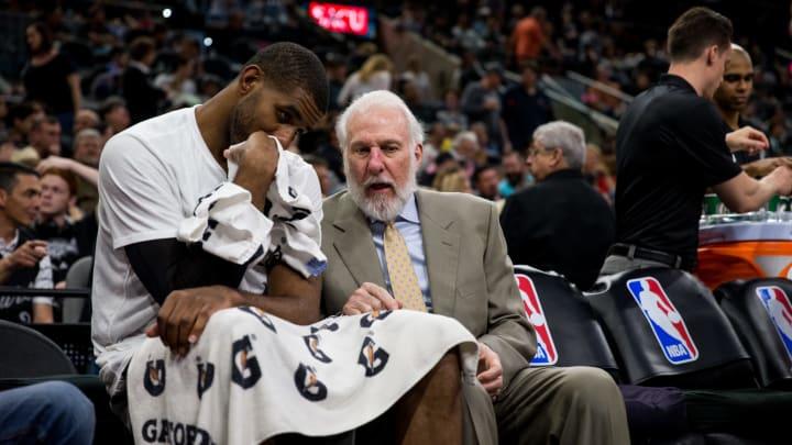 SAN ANTONIO, TX – MARCH 19: Head Coach Gregg Popovich talks with LaMarcus Aldridge #12 of the San Antonio Spurs (Photos by Darren Carroll/NBAE via Getty Images)