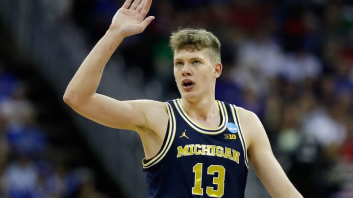 KANSAS CITY, MO - MARCH 23: Moritz Wagner #13 of the Michigan Wolverines reacts against the Oregon Ducks during the 2017 NCAA Men's Basketball Tournament Midwest Regional at Sprint Center on March 23, 2017 in Kansas City, Missouri. (Photo by Jamie Squire/Getty Images)