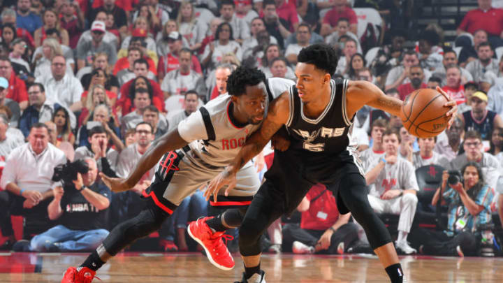 HOUSTON, TX - MAY 7: Dejounte Murray #5 of the San Antonio Spurs handles the ball during the game against Patrick Beverley #2 of the Houston Rockets during Game Four of the Western Conference Semifinals of the 2017 Playoffs on May 7, 2017 at the Toyota Center in Houston, Texas. NOTE TO USER: User expressly acknowledges and agrees that, by downloading and or using this photograph, User is consenting to the terms and conditions of the Getty Images License Agreement. Mandatory Copyright Notice: Copyright 2017 NBAE (Photo by Jesse D. Garrabrant/NBAE via Getty Images)