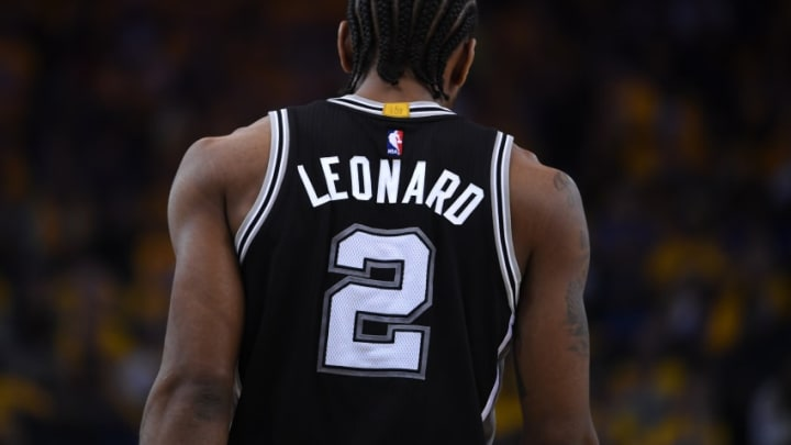 OAKLAND, CA - MAY 14: Kawhi Leonard #2 of the San Antonio Spurs stands on the court during Game One of the NBA Western Conference Finals against the Golden State Warriors at ORACLE Arena on May 14, 2017 in Oakland, California. NOTE TO USER: User expressly acknowledges and agrees that, by downloading and or using this photograph, User is consenting to the terms and conditions of the Getty Images License Agreement. (Photo by Thearon W. Henderson/Getty Images)