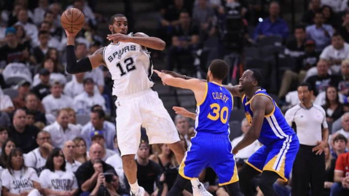 SAN ANTONIO, TX - MAY 20: LaMarcus Aldridge #12 of the San Antonio Spurs looks to pass the ball against Stephen Curry #30 and Draymond Green #23 of the Golden State Warriors in the first half during Game Three of the 2017 NBA Western Conference Finals at AT&T Center on May 20, 2017 in San Antonio, Texas. NOTE TO USER: User expressly acknowledges and agrees that, by downloading and or using this photograph, User is consenting to the terms and conditions of the Getty Images License Agreement. (Photo by Ronald Martinez/Getty Images)