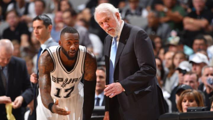 SAN ANTONIO, TX - MAY 22: Head Coach Gregg Popovich of the San Antonio Spurs talks to Jonathon Simmons