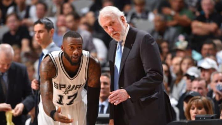 SAN ANTONIO, TX – MAY 22: Head Coach Gregg Popovich of the San Antonio Spurs talks to Jonathon Simmons