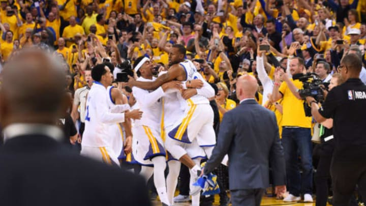 OAKLAND, CA – JUNE 12: The Golden State Warriors celebrate defeating the Cleveland Cavaliers in Game Five of the 2017 NBA Finals on June 12, 2017 at Oracle Arena in Oakland, California. NOTE TO USER: User expressly acknowledges and agrees that, by downloading and or using this photograph, user is consenting to the terms and conditions of Getty Images License Agreement. Mandatory Copyright Notice: Copyright 2017 NBAE (Photo by: Noah Graham/NBAE via Getty Images)