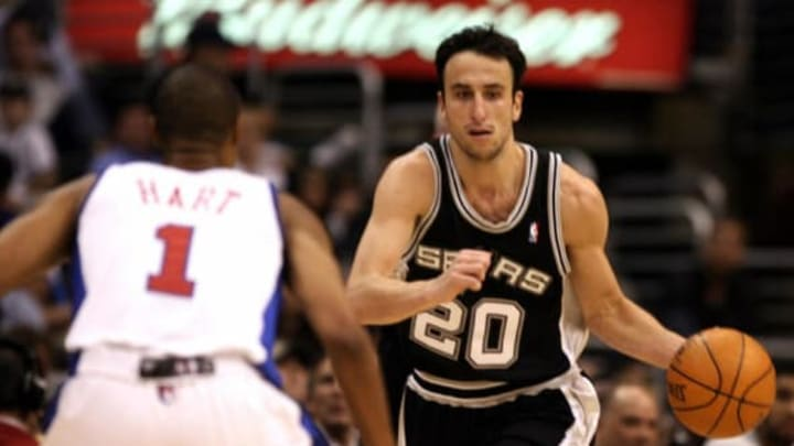 Los Angeles, UNITED STATES: Manu Ginobili (R) of the San Antonio Spurs moves the ball before Jason Hart (Photo credit should read GABRIEL BOUYS/AFP/Getty Images)