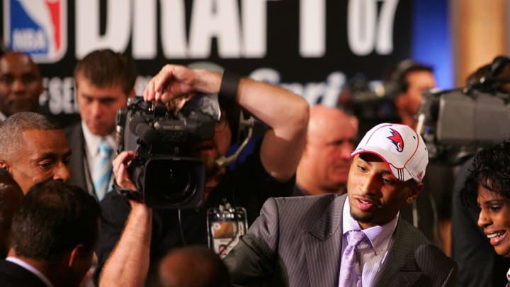 NEW YORK – JUNE 28: Acie Law IV of Texas celebrates after he was drafted eleventh by the Atlanta Hawks during the 2007 NBA Draft at the WaMu Theatre at Madison Square Garden June 28, 2007 in New York City. (Photo by Chris McGrath/Getty Images)