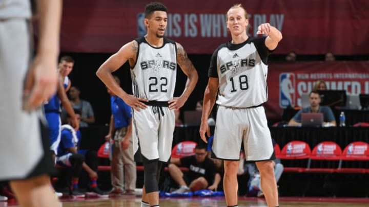 LAS VEGAS, NV - JULY 9: Oliver Hanlan #22 and Jeff Ledbetter #18 of the San Antonio Spurs look on during the game against the Philadelphia 76ers during the 2017 Las Vegas Summer League on July 9, 2017 at the Thomas & Mack Center in Las Vegas, Nevada. NOTE TO USER: User expressly acknowledges and agrees that, by downloading and/or using this Photograph, user is consenting to the terms and conditions of the Getty Images License Agreement. Mandatory Copyright Notice: Copyright 2017 NBAE (Photo by Garrett Ellwood/NBAE via Getty Images)