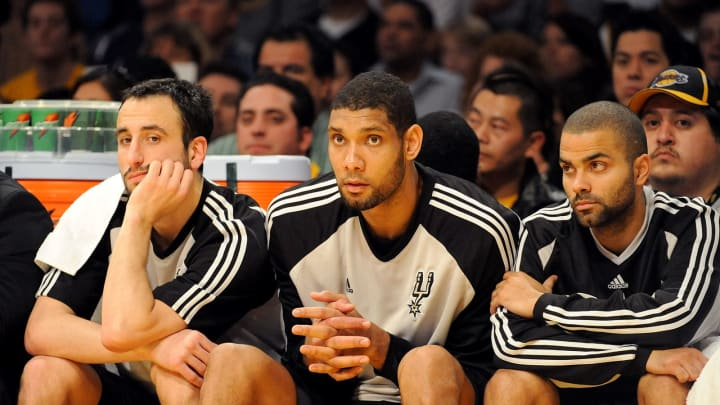 LOS ANGELES, CA – JANUARY 25: (L-R) Manu Ginobili #20, Tim Duncan #21, and Tony Parker #9 of the San Antonio Spurs watch from the sidelines against the Lakers at the Staples Center in 2009. (Photo by Harry How/Getty Images)