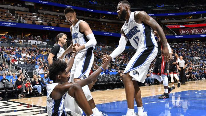 ORLANDO, FL – OCTOBER 7: Nikola Vucevic #9 and Jonathon Simmons #17 help up teammate Jonathan Isaac #1 of the Orlando Magic (Photo by Fernando Medina/NBAE via Getty Images)