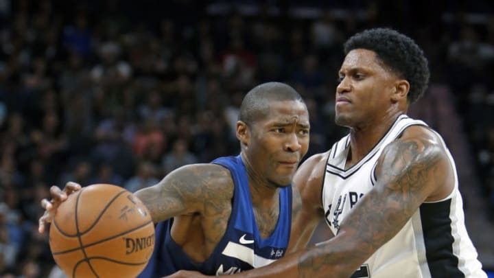 SAN ANTONIO,TX - OCTOBER 18: Rudy Gay #22 of the San Antonio Spurs defense against Jamal Crawford #11 of the Minnesota Timberwolves at AT&T Center on October 18, 2017 in San Antonio, Texas. NOTE TO USER: User expressly acknowledges and agrees that , by downloading and or using this photograph, User is consenting to the terms and conditions of the Getty Images License Agreement. (Photo by Ronald Cortes/Getty Images)