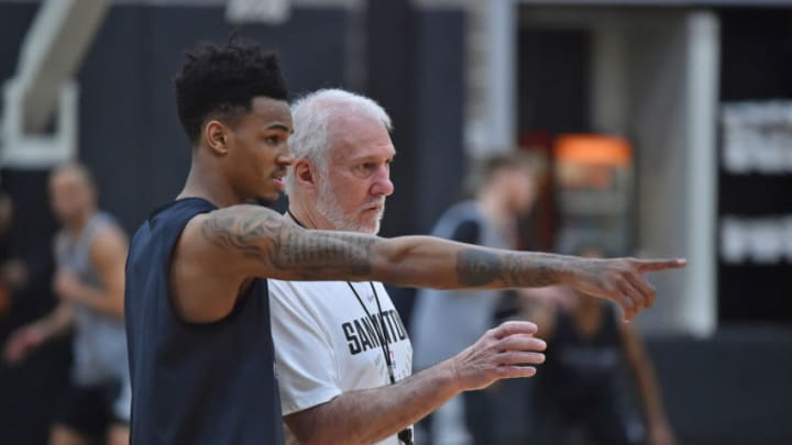 SAN ANTONIO, TX - OCTOBER 12: Gregg Popovich coaches Dejounte Murray #5 of the San Antonio Spurs during an all access practice on October 10, 2017 in San Antonio, Texas at the Spurs Practice Facility. NOTE TO USER: User expressly acknowledges and agrees that, by downloading and/or using this Photograph, user is consenting to the terms and conditions of the Getty Images License Agreement. Mandatory Copyright Notice: Copyright 2017 NBAE (Photo by Robin Jerstad/NBAE via Getty Images)