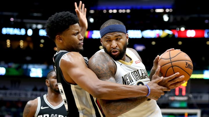 NEW ORLEANS, LA – NOVEMBER 22: DeMarcus Cousins #0 of the New Orleans Pelicans is fouled by Rudy Gay #22 of the San Antonio Spurs during the second half of a NBA game (Photo by Sean Gardner/Getty Images)