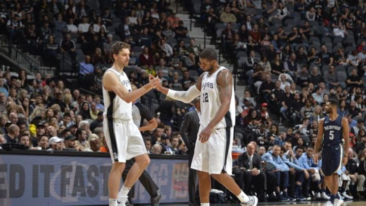 SAN ANTONIO, TX - NOVEMBER 29: Pau Gasol #16 and LaMarcus Aldridge #12 of the San Antonio Spurs shake hands during the game against the Memphis Grizzlies on November 29, 2017 at the AT&T Center in San Antonio, TX. NOTE TO USER: User expressly acknowledges and agrees that, by downloading and or using this photograph, User is consenting to the terms and conditions of the Getty Images License Agreement. Mandatory Copyright Notice: Copyright 2017 NBAE (Photo by Mark Sobhani/NBAE via Getty Images)