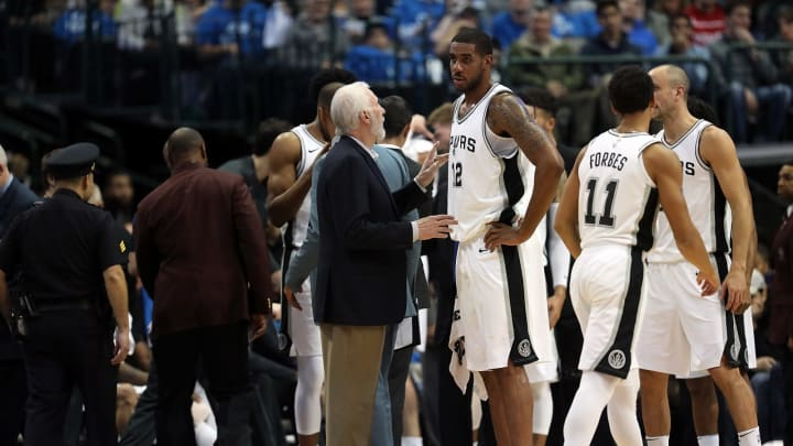 DALLAS, TX – DECEMBER 12: Head coach Gregg Popovich of the San Antonio Spurs talks with LaMarcus Aldridge #12 during play against the Dallas Mavericks (Photo by Ronald Martinez/Getty Images)