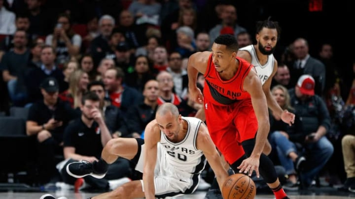 PORTLAND, OR - JANUARY 07: C.J. McCollum #3 of the Portland Trail Blazers dribbles past Manu Ginobli #20 of the San Antonio Spurs at Moda Center on January 7, 2018 in Portland, Oregon. NOTE TO USER: User expressly acknowledges and agrees that, by downloading and or using this photograph, User is consenting to the terms and conditions of the Getty Images License Agreement.