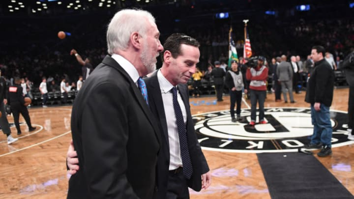 NEW YORK, NY - JANUARY 17: Coaches Gregg Popovich of the San Antonio Spurs and Kenny Atkinson of the Brooklyn Nets talk before the NBA game at Barclays Center on January 17, 2018 in Brooklyn, New York. NOTE TO USER: User expressly acknowledges and agrees that, by downloading and or using this photograph, User is consenting to the terms and conditions of the Getty Images License Agreement. (Photo by Matteo Marchi/Getty Images)