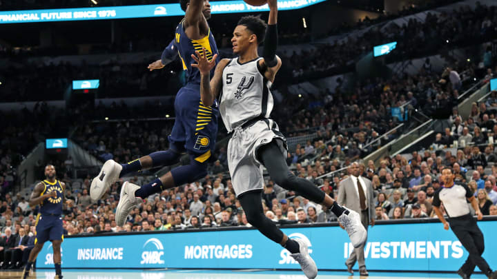 SAN ANTONIO, TX – JANUARY 21: Dejounte Murray #5 of the San Antonio Spurs passes after being cut off at the basket by Victor Oladipo #4 of the Indiana Pacers at AT&T Center on January 21, 2018. (Photo by Ronald Cortes/Getty Images)